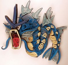Paper Quilling Gyarados - 130 by wholedwarf on DeviantArt Quilling Cake, Arte Quilling, Origami And Quilling, Quilled Paper Art, Quilling Patterns, Quilling Designs, Quilling Ideas, Quilling Instructions, Quilled Creations