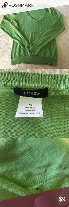 J Crew 100% Cotton Spring V Neck Sweater V Neck Sweater perfect for spring/summer transition. Very small hole on left shoulder as seen in picture. Machine wash warm/dry flat. I really like the color but it doesn't go with my skin tone. Check out the shorts I have in my closet. Bundle and save!! J. Crew Sweaters V-Necks