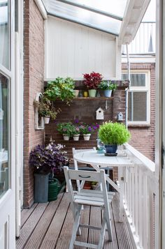 At the backside of the house, the dining room patio doors open up to this quaint little balcony.