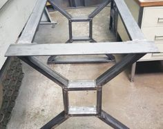 This listing is for set of 2 Steel X Legs. - Made from 3 by .25 thick Flat Steel Bar. Inner squire is 8 x 8, but if you want different dimensions, just put a notice when you buying. - Legs are predrilled. - Finish - Raw steel, Clear coated, Black flat. ** Not included Screws ***Working with custom dimensions. Fast quote***