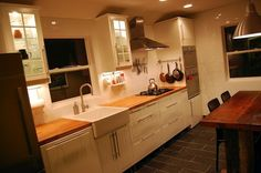 slate floors, butcher block counters, ikea cabinets by lenore