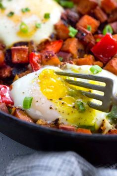 Healthy sweet potato hash with eggs is a simple to prepare breakfast made in one pan. Sauteed potatoes and bell peppers are seasoned with smoked paprika for a savory flavor. Over easy eggs are baked right in the skillet for extra protein. #whole30 #healthyrecipes