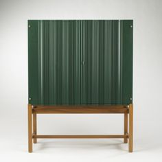 Josef Frank; #2192 Wood and Brass Cabinet for Svenskt Tenn, 1954.