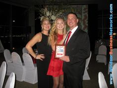 Mark Jones, winner of Powerhouse Professional with his wife on the left and daughter in the centre.