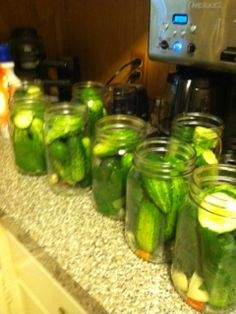 add to each of your clean hot 6 each quart canning jars: 1/8 tsp of Alum, 1 clove garlic, 2 dill heads, 1 grape leaf, 1 hot red pepper (small) , a chunk of white onion & your cucumbers.