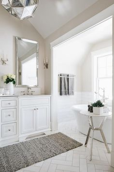 Transitional bathroom designed with light taupe walls and a white washstand topped with a white quartz countertop. Light Grey Bathrooms, Taupe Bathroom, Modern Bathroom, Small Bathroom, Dyi Bathroom, Bathroom Flooring, Grey Painted Walls, Taupe Walls, Light Grey Walls