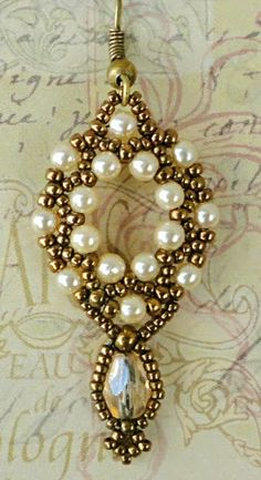 While browsing Pinterest, I came upon this necklace photo and it gave me an idea for embellishing a crystal drop bead:       What I came up...