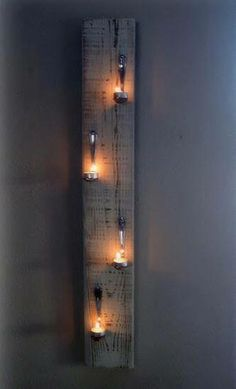 Very Cool feature for backyard retreats! Bent spoons with tealight candles