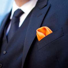 You could just do a pocket square with the color of the wedding.  Maybe the best man can have a different color than the groomsmen.  nice idea!