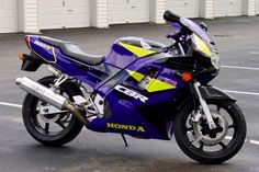 Still my favorite motorcycle: the 1994 Honda CBR600F2 in Black/Yellow/Purple. There are many bikes out there these days that are faster/lighter/better, but I've always wanted one of these.