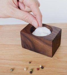 A handmade walnut salt cellar for easy access to pinches of salt while cooking in the kitchen.