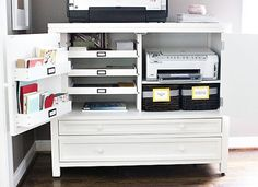 Organized printer station. Slide out trays, bins attached to the cabinet doors, and wide drawers keep all of your papers and printer supplies neat and organized.
