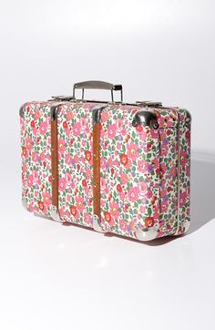 A vintage valise covered in floral Liberty fabric serves as a love letter to old-fashioned travel.
