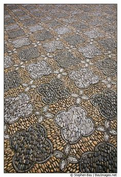 Pebble Mosaic floor.  Do you realize how long it would take to set each one of these pebbles?  This floor probably took a loooooong time to create!  Stunning!