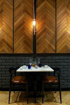 PizzaExpress restaurant, India, by Urban Studio _Timber wall cladding, parquet detail, metro brick tiles