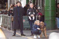 The dog whisperer: Amanda attempts to reassure the dog as the trio prepare to shoot a scen...