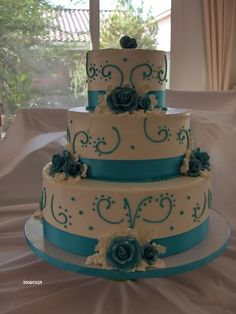 Teal roses wedding cake