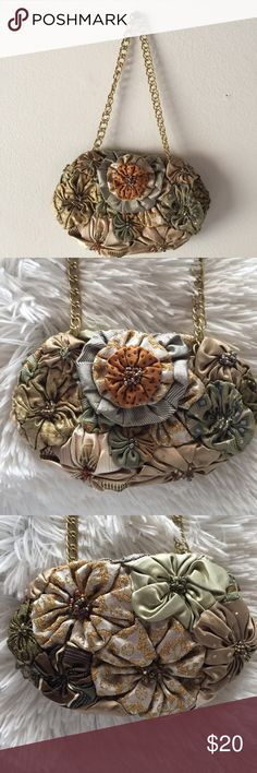 "Tiny Silk Evening Bag Handmade silk blossoms stitched together to form an adorable little bag. Chain can be used or talked in the bag and use as a clutch. Measures 6 1/2"" x 4"". Just big enough for money and lipstick. Or a tiny cell phone. Bags Clutches & Wristlets"