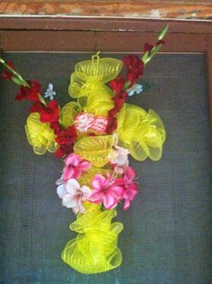 Deco-Mesh wreaths seem to be really popular now. This past Easter I used deco-mesh to make a 'Cross Wreath' for mom.    I started with a ba...