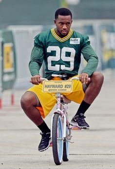 Green Bay Packers' Casey Hayward rides a bike to NFL football training camp Friday in Green Bay, Wis. (Morry Gash/AP)