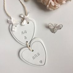 The clay hearts are stamped with Mrs and Mrs, with heart shaped edge detail and a small heart stamped at the bottom, the le. Wedding Letters, Garland Wedding, Wedding Signs, Wedding Decor, Rustic Wedding, Wedding Cake, Wedding Flowers, Handmade Wedding Gifts, Personalized Wedding Gifts
