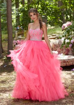 Prom Dresses by Morilee designed by Madeline Gardner. Tulle Prom Gown with Beaded Bodice and Full Ruffled Skirt.