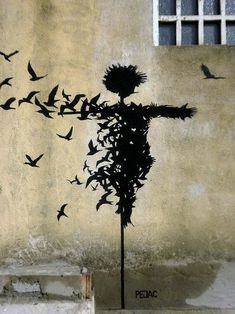 Spanish streetartist Pejac. Mostly black and white art,  mostly with a political or social background