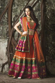 Net ghagra and raw silk blouse with contrast border embellished with appliqué work along with net dupatta.