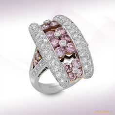 Mouawad loves placing luxury on your finger. This pink diamond, 18K White and Rose Gold Ring should do the trick.