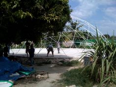 Grassroots United building a 60' DomeGuys dome in Haiti after the earthquake for a temporary shelter.