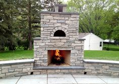 Fondulac Stone and Bluestone Outdoor Fireplace and Pizza oven with Sitting Walls and Bluestone Patio