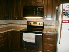 Santa Cecilia Reale 5 3 13  Granite Countertops Installed in China Grove NC  70/30 sink  Half Bullnose edge  4x4 Travertine tiles and 1x1 earth glass tiles  Dark wood kitchen cabinets  Visit us at http://www.fireplacecarolina.com  To See Our GRANITE COUNTERTOP PACKAGE DEAL