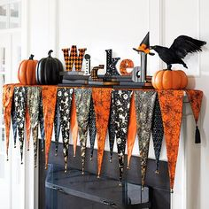 Slip the Bewitching Mantel Scarf over the shelf of your mantel, then top it with your favorite Halloween decorations and create an unforgettable display. Layered, pennant-shaped composition is made fr (Halloween Table Arrangements) Casa Halloween, Halloween Mantel, Halloween Home Decor, Halloween Projects, Holidays Halloween, Halloween Treats, Halloween Bunting, Cheap Halloween Decorations, Halloween Activities