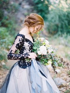 edgy black lace wedding gown with a white tulle skirt