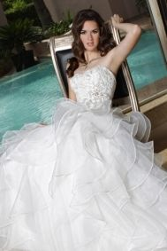 Da Vinci Wedding Dress - Spring 2013 - Style 50162. This exquisitely romantic ball gown features a strapless sweetheart neckline, a lovely lace bodice, a wide waistband with beaded accent, and a full skirt of layered organza ruffles. $711.00