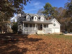 CONVENIENCE DEFINED: Lovely 1 1/2 story home sets on paved county road just outside city limits. Full partially finished basement; storage room above attached garage. Covered front porch, back deck. 3 BR above grade, with another partially finished BR in basement. 20 acres m/l. $239,900 in Willow Springs MO