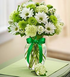 Send a green bouquet for St. Patrick's Day with our Lucky Day Bouquet, featuring carnations, poms, monte casino and a removable green boutonniere!