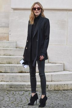French fancy:Layering up, she donned a black pussybow blouse, leaving her neck-tie loose and trailing past a military style coat that she bundled over her lithe frame as she stepped out on the Parisian cobbles