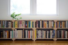 perfect cool simple nice compact under window bookcase with small wooden made concept and has two levels storage with many books