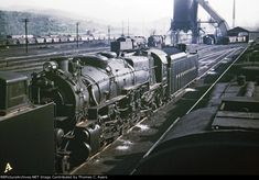"""Here is a 35mm color slide taken in East Altoona, Pennsylvania, in June of 1951. Prominent here is Pennsylvania Railroad engine #6704, an M-1A (4-8-2) """"Mountain"""" built by the Baldwin Locomotive Works during March of 1930 and retired in June of 1959. Partially visible in the background is the East Altoona Coaling Tipple."""