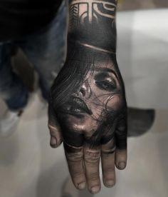 woman portrait tattooed on hand. hand tattoo