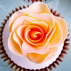 Yum! Inside the rose #cupcakes #cute #rose #orange #sugarart #sugarflower www.delicatessepostres.com Sugar Art, Sugar Flowers, Cupcakes, Orange, Rose, Desserts, Deserts, Tailgate Desserts, Cupcake Cakes