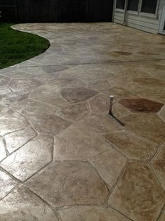 stamped concrete patiomuch cheaper than flagstone or pavers and