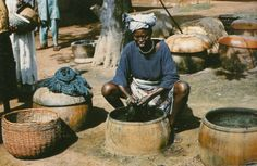 """A Yoruba indigo dyer, Nigeria, 1960s. [Scanned from """"African textiles"""" by Picton & Mack, (1979.)]"""