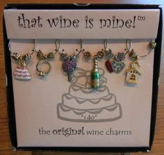 "I Do! Wine Glass Charms Celebrate Your Wedding - from That Wine Is Mine - 1410P by Wine Things Unlimited. $12.50. Never Get Wine Glasses Mixed Up Again. Die Cast, Hand Painted Metal Charms. Great Gifts or Favors. Set of Six Wine Glass Charms. From the Original - That Wine Is Mine. The wedding bells are ringing with this ""I DO!"" wedding wine charm collection! Perfect for engagements, receptions, or even bachelorette parties, this collection will surely seal the deal. Since ea..."