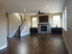 Additional discounts available to Pinterest users call 1.800.906.6242 Lexington compliments the stone in this fireplace beautifully.   Free samples of this floor available call 1.800.906.6242 http://www.simplefloors.com/hardwood-floors/engineered-hardwood-floors/aged-betula/aged-betula-lexington-handscraped-engineered-hardwood.html