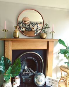 Modern fireplaces and Round mirrors