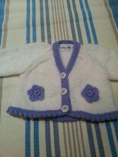 Knitted newborn baby girls cardigan.