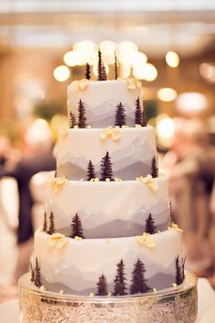 Love how the baker painted a frosting mountainscape and added trees made of chocolate.  This would be perfect for a winter wedding!