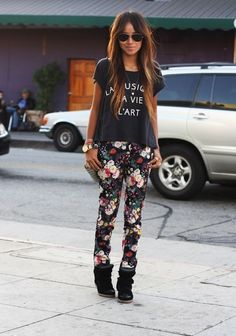 floral print, wedged sneakers, and casual tee. ...